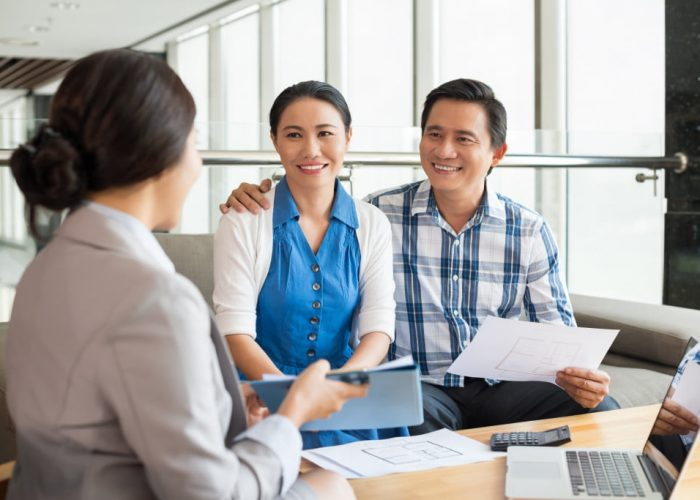 Middle-aged couple at the meeting with real estate agent